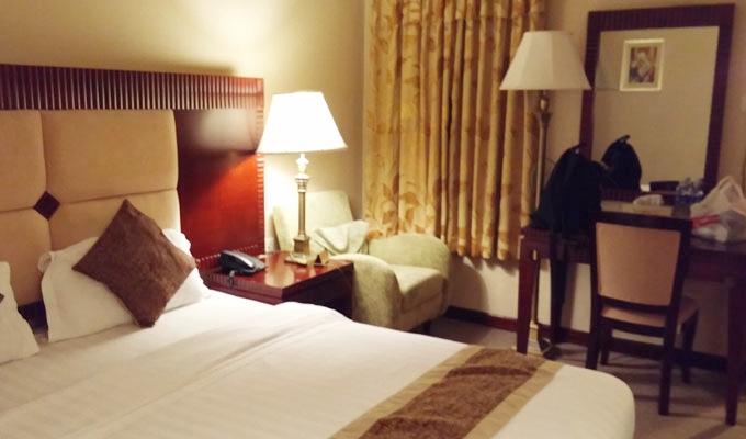ベトナム・ホーチミン市。ホテルのベッドルーム