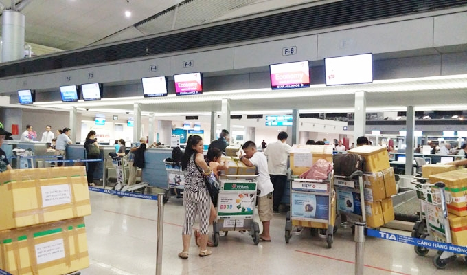 ベトナム・ホーチミン市。ホーチミン・シティ。タンソンニャット国際空港。搭乗手続き
